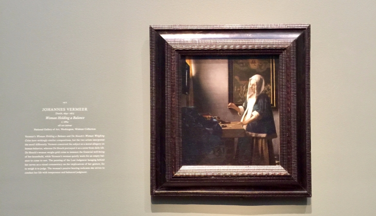 Woman Holding a Balance by Johannes Vermeer